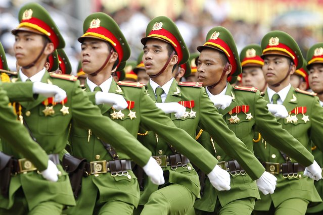 Vietnamese policemen march during celebrations marking the 60th anniversary of the Dien Bien Phu victory, in the northern province of Dien Bien, Vietnam 07 May 2014. Vietnam will celebrate the 60th anniversary of Dien Bien Phu battle, a confrontation in the first Indochina War between French troops and Viet Minh revolutionaries, on 07 May 2014. (Photo by Luong Thai Linh/EPA)