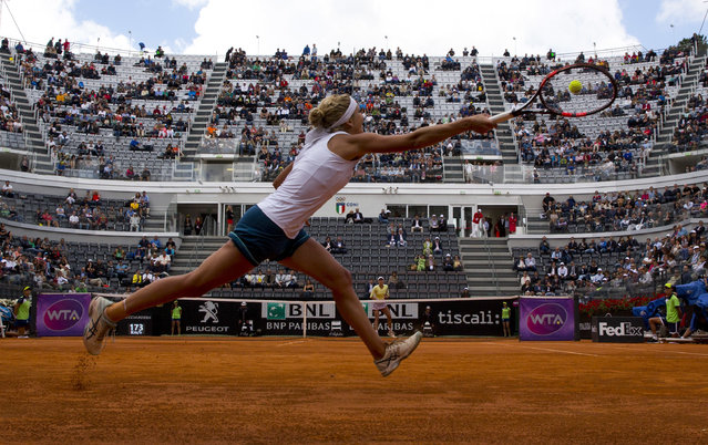 Timea Bacsinszky stretches to hit a forehand during a quarter final match against Garbine Muguruza, at the Italian Open tennis tournament, in Rome, Friday, May 13, 2016. (Photo by Alessandra Tarantino/AP Photo)