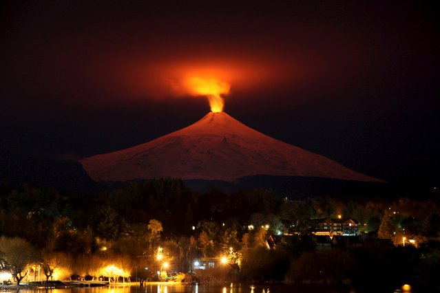 The Villarrica Volcano is seen at night from Pucon town, Chile, July 12, 2015. Villarrica, located near the popular tourist resort of Pucon, is among the most active volcanoes in South America. (Photo by Cristobal Saavedra/Reuters)
