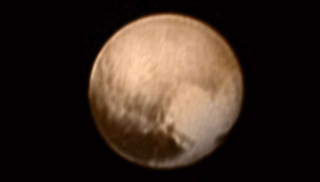 Pluto is pictured in this July 7, 2015 handout image from New Horizons Long Range Reconnaissance Imager (LORRI).This image, the most detailed yet returned by the LORRI aboard New Horizons -- has been combined with lower-resolution color information from the Ralph instrument. (Photo by Reuters/NASA)