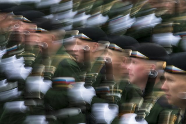 Russian soldiers march along Red Square during the Victory Day military parade in Moscow, on Tuesday, May 9, 2017. (Photo by Alexander Zemlianichenko/AP Photo)