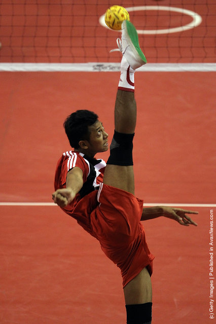 Sepaktakraw: E.P. Victoria of Indonesia competes against Japan during day one of the ISTAF Super Series at Palembang Sport Convention Center