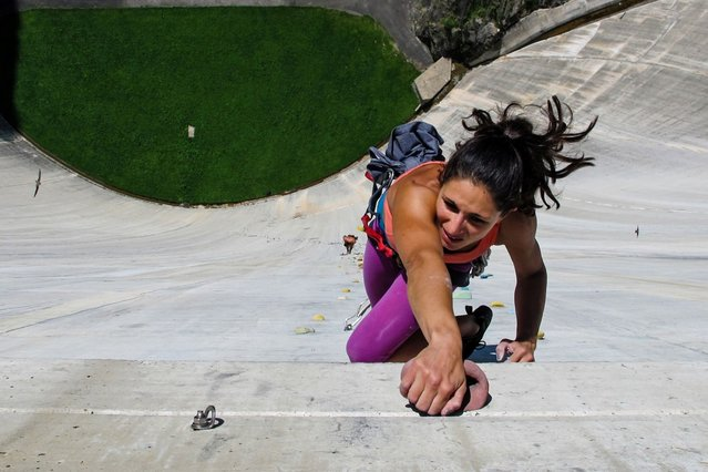 Fearless daredevils clamber up the worlds highest man-made climbing wall – running up the face of a 540ft dam. The Diga di Luzzone in Switzerland is considered by climbers as the Everest of wall climbing. (Photo by Ilana Marcus/Caters News)