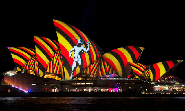 An image of an indigenous Australian man is projected onto the sails of the Sydney Opera House during the opening night of the annual Vivid Sydney light festival in Sydney, Australia, May 27, 2016. (Photo by Jason Reed/Reuters)