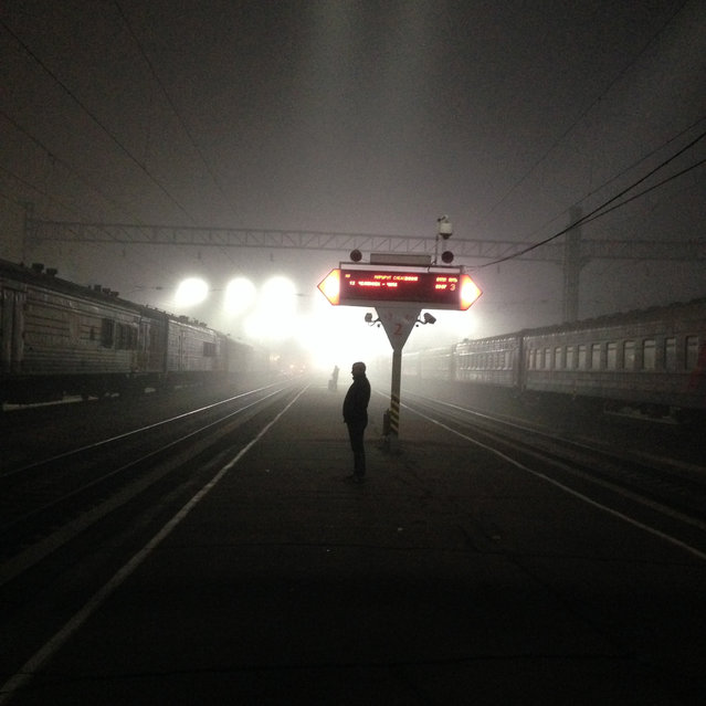 """""""Traveller awaits for the Transsiberian"""". Photo taken in Irkutsk Central Station during a train journey to Lake Baïkal in October 2013. Photo location:  Irkutsk, Russian Federation. (Photo and caption by Romain Poirot-Lellig/National Geographic Photo Contest)"""