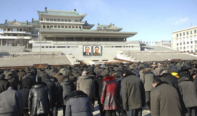 North Koreans bow as they pay respects to mark the third anniversary of the death of former leader Kim Jong Il in this undated photo released December 17, 2014 by North Korea's Korean Central News Agency (KCNA), in Pyongyang. (Photo by Reuters/KCNA)