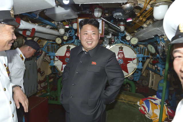 North Korean leader Kim Jong Un (C) visits a submarine during his inspection of the Korean People's Army (KPA) Naval Unit 167 in this undated photo released by North Korea's Korean Central News Agency (KCNA) in Pyongyang June 16, 2014. (Photo by Reuters/KCNA)