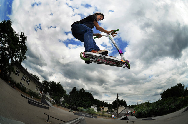 Brandon Franchak, 13, of Carbondale, Pa., glides in the warm summer air on his scooter Thursday, July 10, 2014, at Carbondale Skate Park in Carbondale, Pa. (Photo by Butch Comegys/AP Photo/The Scranton Times-Tribune)