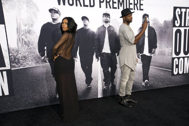 "NBA player Dwyane Wade takes a photo of his wife actress Gabrielle Union at the premiere of ""Straight Outta Compton"" in Los Angeles, California August 10, 2015. The movie opens in the U.S. on August 14. (Photo by Mario Anzuoni/Reuters)"