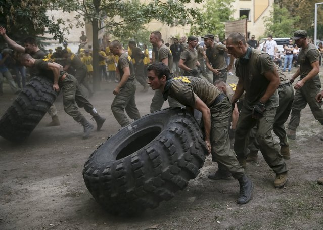 "New volunteers for the Ukrainian interior ministry's ""Azov"" battalion take part in tests before heading to frontlines in eastern Ukraine, at the battalion's training centre in Kiev, Ukraine, August 14, 2015. (Photo by Gleb Garanich/Reuters)"