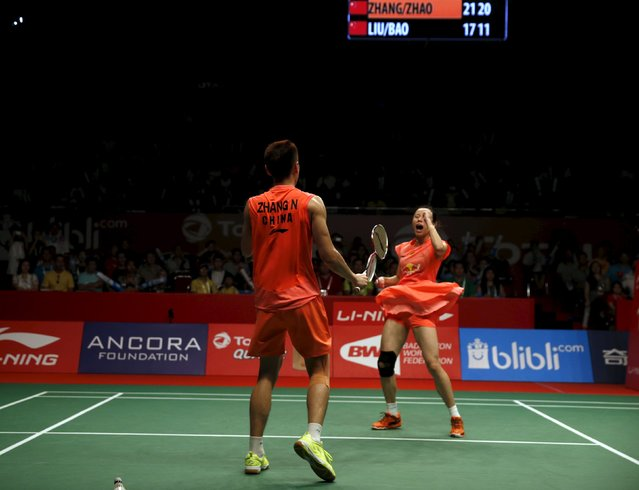 China's Zhang Nan (L) and Zhao Yunlei (R) celebrate their win against compatriots  Liu Cheng and Bao Yixin aftertheir mixed doubles badminton final match at the BWF World Championships in Jakarta, Indonesia, August 16, 2015. (Photo by Darren Whiteside/Reuters)