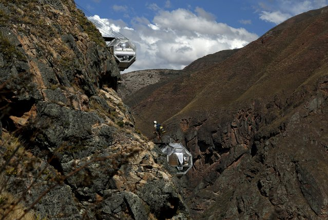 Sleeping pods at the Skylodge Adventure Suites are pictured in the Sacred Valley in Cuzco, Peru, August 14, 2015. (Photo by Pilar Olivares/Reuters)