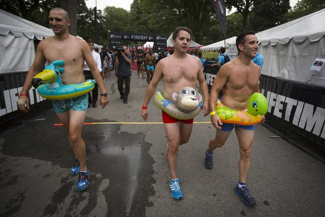 People cross the finish line of the Underwear Run in Central Park in New York August 1, 2014. The run was part of activities before the New York City Triathlon. (Photo by Carlo Allegri/Reuters)