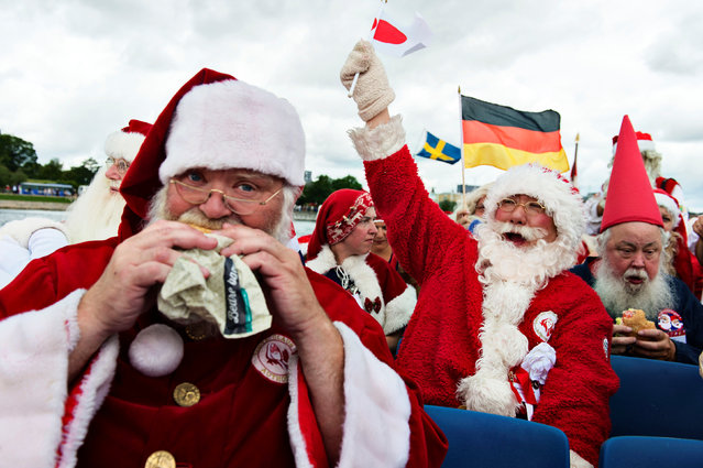 Participants from different countries take part in the 59th World Santa Convention in Copenhagen July 18, 2016. (Photo by Mathias Loevgreen Bojesen/Reuters/Scanpix Denmark)