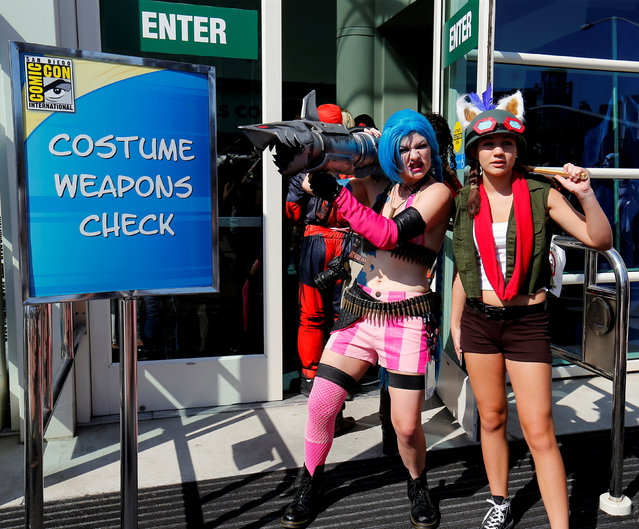 Costumed attendees wait to have their weapons checked by police before entering opening day of the annual Comic-Con International in San Diego, California, United States July 21, 2016. (Photo by Mike Blake/Reuters)
