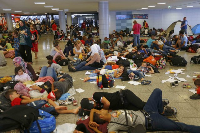 Migrants rest in an underground station near the main Eastern Railway station in Budapest, Hungary, September 1, 2015. (Photo by Laszlo Balogh/Reuters)