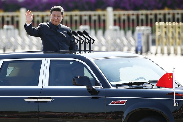 Chinese President Xi Jinping waves as he reviews the army, at the beginning of the military parade marking the 70th anniversary of the end of World War Two, in Beijing, China, September 3, 2015. (Photo by Damir Sagolj/Reuters)