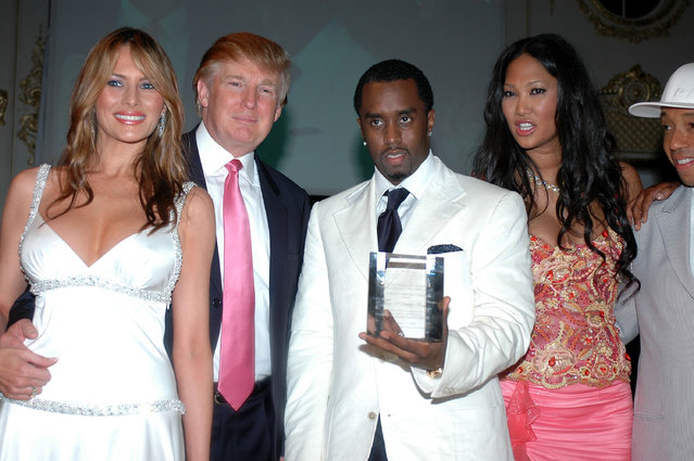 """Donald and Melania Trump, Sean """"P Diddy"""" Combs, Kimora Lee Simmons and Russell Simmons at Russell Simmons """"Art For Life Palm Beach"""" Honoring Sean """"P Diddy"""" Combs at Mar-a-Lago on March 11, 2005 in Palm Beach, Florida. (Photo by Gustavo Caballero/Getty Images)"""