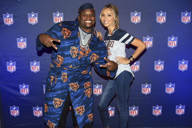 """Chicago Bears legend, Anthony """"Spice"""" Adams, and TV personality and Restaurateur, Giuliana Rancic, host an NFL Homegating celebration on Thursday, September 28, 2017, in Chicago. (Photo by Andrew Weber/AP Images for NFL)"""