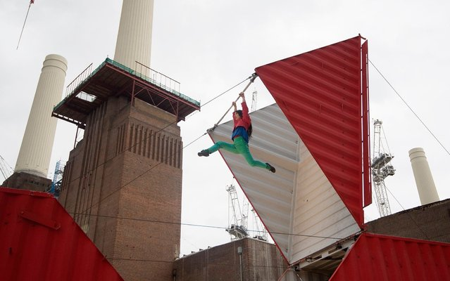 """Satchie Noro performs a work entitled """"Origami"""" which will open the London's Dance Umbrella festival, at a site next to the landmark four tower Battersea Power Station in London, Wednesday, October 11, 2017. The former Battersea Power station is being refurbished in to an apartment complex. The dance festival runs from Oct. 11 to 28, in various locations around London. (Photo by Alastair Grant/AP Photo)"""