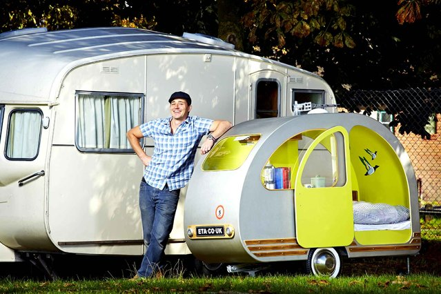 A recent undated handout picture released by the Guinness World Records on September 9, 2014, shows 43-year-old Yannick Read from London, UK, who has secured a place in the 2015 Guinness World Records book for building the world's smallest caravan. The vehicle, which is fully road worthy, measures 2.39m (7ft 10.9in) in length, 1.53 m (5ft 0.24in) high and 0.79 m (2ft 7.9in) wide. (Photo by Paul Michael Hughes/AFP Photo/Guinness World Records)