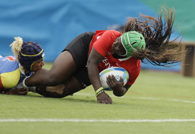 Kenya's Janet Owino, right, is tackle by Colombia's Nathalie Nicole V. Marchino Urrutia, left, during the women's rugby sevens match at the Summer Olympics in Rio de Janeiro, Brazil, Monday, August 8, 2016. (Photo by Themba Hadebe/AP Photo)