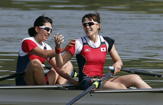 Japan's Eri Wakai (bow) and Asumi Suehiro react after finishing second in the women's lightweight double sculls final race of the rowing competition at the Chungju Tangeum Lake International Rowing Center, during the 17th Asian Games in Incheon, September 25, 2014. (Photo by Kim Hong-Ji/Reuters)