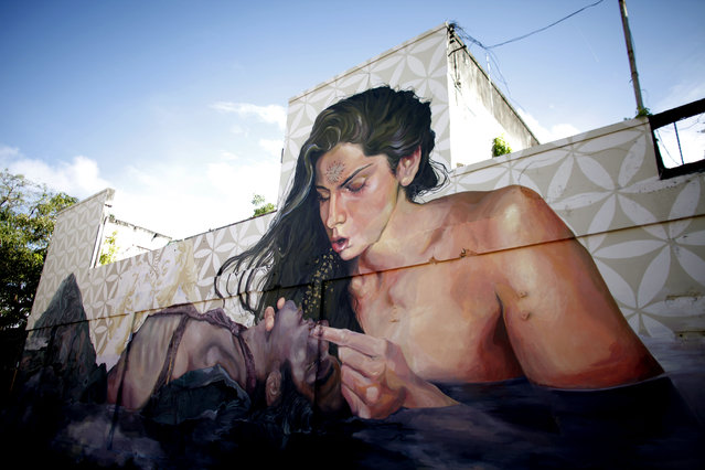This September 22, 2014 photo, shows a building with street art murals in the Santurce neighborhood in San Juan, Puerto Rico. (Photo by Ricardo Arduengo/AP Photo)