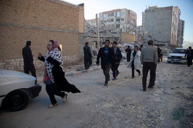 People react as they run following an earthquake in Sarpol-e Zahab county in Kermanshah, Iran, Monday, November 13, 2017. (Photo by Reuters/Tasnim News Agency)