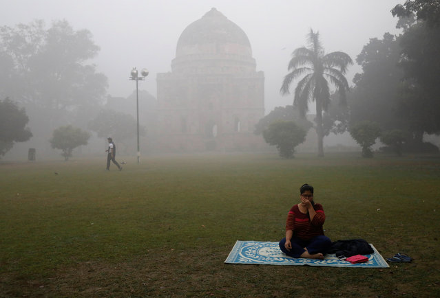 A woman exercises inside a park on a smoggy morning in New Delhi, India, November 9, 2017. (Photo by Saumya Khandelwal/Reuters)