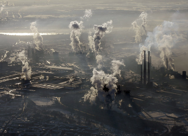 """In this January 9, 2009 file photo is an aerial view of the steel company ThyssenKrupp in Duisburg, western Germany. Inger Andersen, head of the U.N. Environment Program, says the world needs """"quick wins to reduce emissions as much as possible in 2020"""". Ahead of a global climate summit in Madrid next week, her agency published a report Tuesday showing the amount of planet-heating gases released into the atmosphere hitting a new high last year. (Photo by Frank Augstein/AP Photo/File)"""