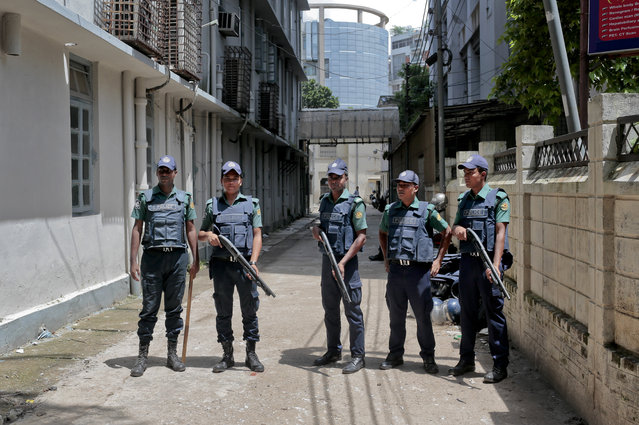 In this Wednesday, July 27, 2016, file photo, Bangladeshi policemen stand guard outside a morgue at the Dhaka Medical College Hospital during the autopsy on the bodies of suspected Islamic militants who were killed in Dhaka, Bangladesh. Police in Bangladesh, on Saturday, say they have killed three suspected militants, including one of two alleged masterminds of a major attack on a cafe last month that left 20 people dead. Top counterterrorism official Monirul Islam said police raided a two-story house in Narayanganj district near Dhaka and killed the suspects early Saturday. (Photo by AP Photo)