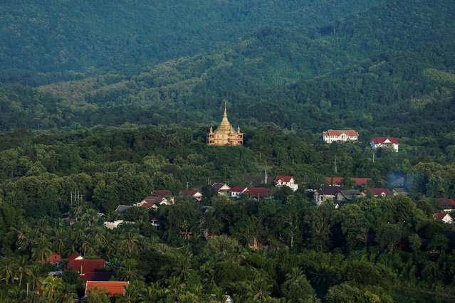 Luang Prabang is seen from Mount Phousi, a high hill in the center of the old town of Luang Prabang, Laos July 31, 2016. (Photo by Jorge Silva/Reuters)
