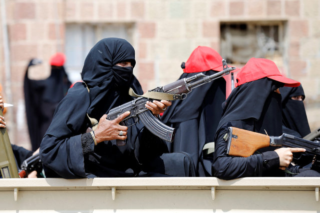 Armed women ride on the back of a truck as they take part in a parade to show support for the movement in Sanaa, Yemen September 6, 2016. (Photo by Khaled Abdullah/Reuters)