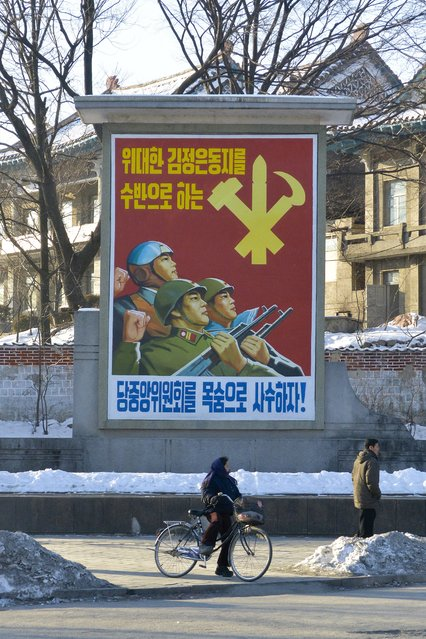 A poster for the Worker's Party of Korea in February 2013, in Pyongyang, North Korea. (Photo by Andrew Macleod/Barcroft Media)