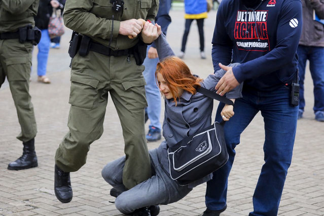 Police officers detain a woman during a rally in support of Maria Kolesnikova, a member of the Coordination Council created by the opposition to facilitate talks with Lukashenko on a transition of power, was detained Monday in the capital of Minsk with two other council members, in Minsk, Belarus, Tuesday, September 8, 2020. (Photo by AP Photo/Stringer)