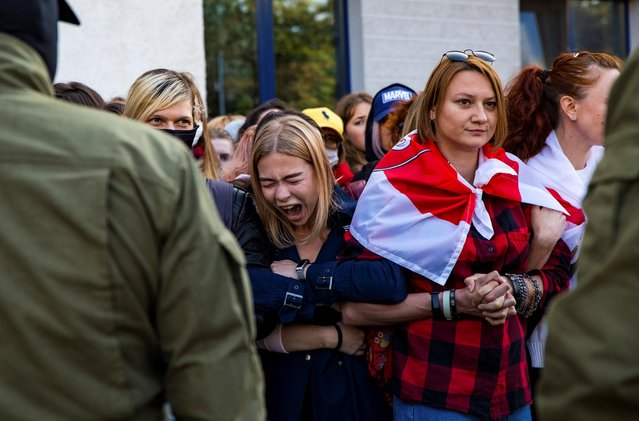 Women blocked by Belarusian law enforcement officers gather during an opposition rally to protest against police brutality and to reject the presidential election results in Minsk, Belarus on September 19, 2020. (Photo by BelaPAN via Reuters)