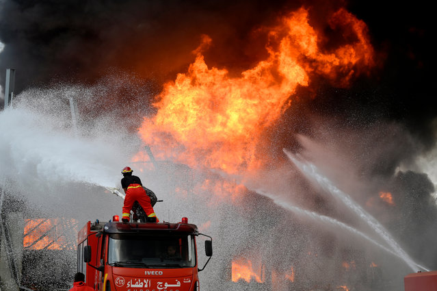 Lebanese firefighters try to extinguish a fire at a Port of Beirut, Lebanon, 10 September 2020. A massive fire is raging at the port of Beirut, a little more than a month after a huge explosion rocked the harbor facilities and surrounding area. The cause of the fire was not immediately known. (Photo by Wael Hamzeh/EPA/EFE)