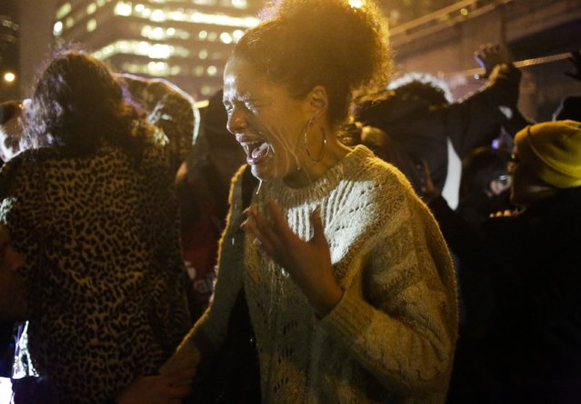 A protester reacts to being pepper sprayed by police after a group of demonstrators attempted to stop traffic on Interstate 5 following the grand jury decision in the Ferguson, Missouri shooting of Michael Brown, in Seattle, Washington, November 24, 2014. The case has highlighted long-standing racial tensions not just in predominantly black Ferguson, Missouri but across the United States. (Photo by Jason Redmond/Reuters)