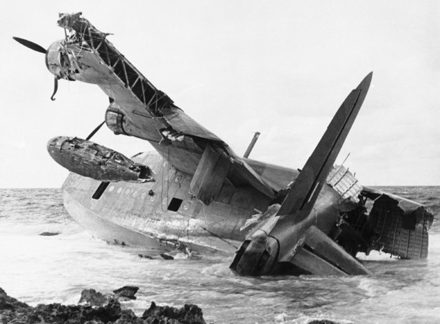 The huge Sunderland flying boat soon began to break up and was left to the mercy of the sea, somewhere near apollonian in Cyrenaica, Libya, January 31, 1942. As the men shivered while drying their clothes, 20 Italian soldiers appeared. (Photo by AP Photo)
