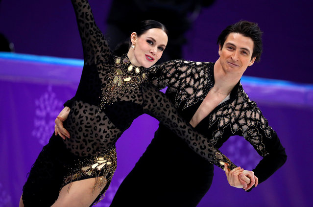 Canada' s Tessa Virtue and Canada' s Scott Moir compete in the ice dance short dance of the figure skating event during the Pyeongchang 2018 Winter Olympic Games at the Gangneung Ice Arena in Gangneung on February 19, 2018. (Photo by Phil Noble/Reuters)