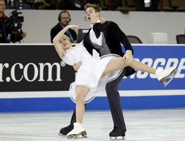 Anna Yanovskaya and Sergey Mozgov of Russia lose their balance as they perform during the ice dance short program at the Skate America figure skating competition in Milwaukee, Wisconsin October 23, 2015. (Photo by Lucy Nicholson/Reuters)