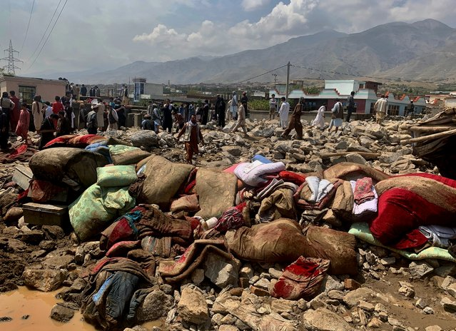 Afghans rescue people after heavy flooding in an area in the Parwan province, Afghanistan, Wednesday, August 26, 2020. Heavy flooding in northern Afghanistan has killed dozens of people and injured scores of others, officials said Wednesday. (Photo by Rahmat Gul/AP Photo)