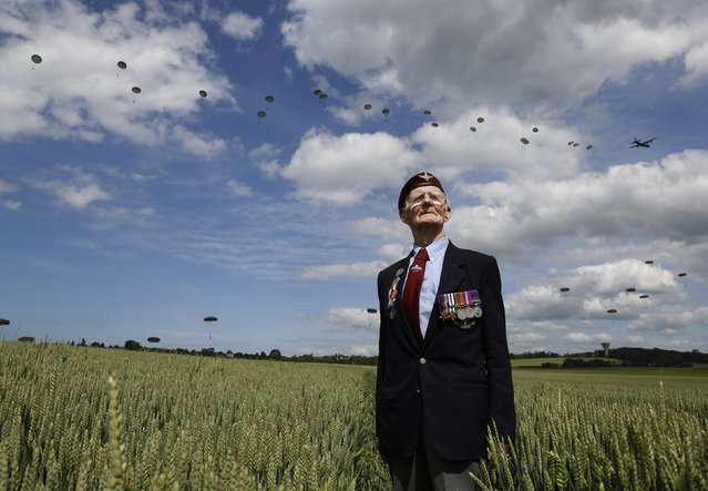 British D-Day veteran of the Normandy campaign Fred Glover, 88, of Brighton, poses while watching a display by 300 multinational paratroops in Ranville, France, in this June 5, 2014 file photo. (Photo by Chris Helgren/Reuters)