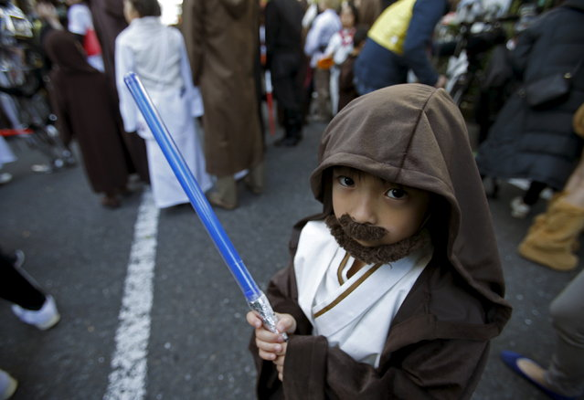 """A boy dressed up as a character from """"Star Wars"""" take part in a Star Wars parade, part of the Halloween parade in Kawasaki, south of Tokyo, October 25, 2015. (Photo by Yuya Shino/Reuters)"""