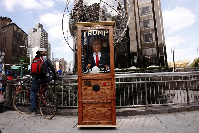 A Donald Trump themed fortune telling machine stands on the street in Columbus Circle in New York, U.S., October 12, 2016. (Photo by Lucas Jackson/Reuters)