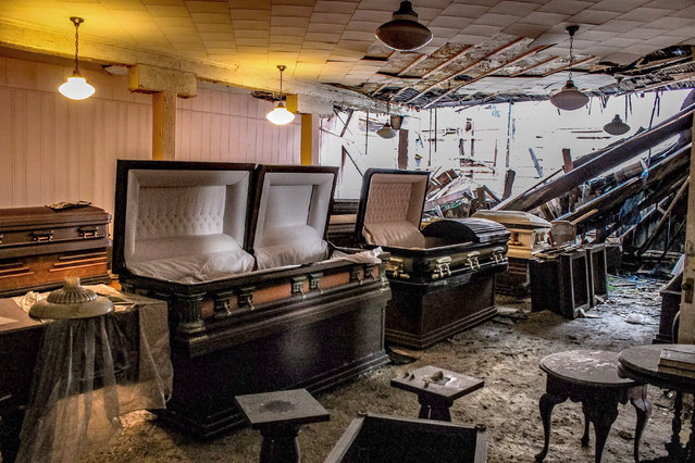 The downstairs area is very dark. The carpet is wet and moldy from the partially collapsed roof. The upstairs floors are soft from the water damage, and a visitor could easily fall through if not careful. (Photo by Abandoned Southeast/Caters News Agency)
