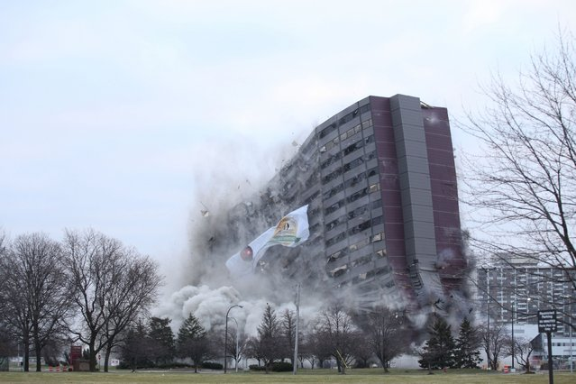 The North Park Plaza building is imploded on Sunday, December 14, 2014 in Southfield, Mich. Oakland Community College owns the property just north of Detroit and auctioned off the chance to blow it up to the highest bidder. The college bought the 42-year-old building earlier this year and says it has no immediate plans for the land. (Photo by Tim Galloway/AP Photo/Detroit Free Press)