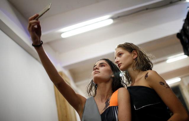 Models take selfie backstage at the Tbilisi Fashion Week in Tbilisi, Georgia, October 21, 2016. (Photo by David Mdzinarishvili/Reuters)