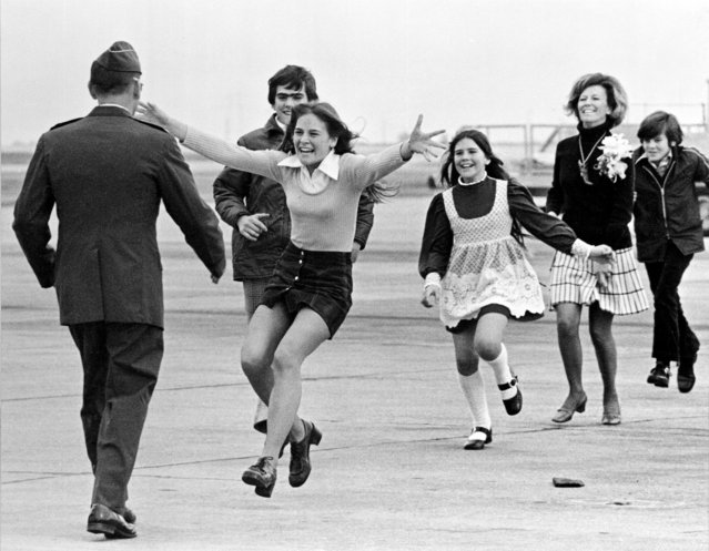Released prisoner of war Lt. Col. Robert L. Stirm is greeted by his family at Travis Air Force Base in Fairfield, Calif., as he returns home from the Vietnam War, March 17, 1973.  In the lead is Stirm's daughter Lori, 15; followed by son Robert, 14; daughter Cynthia, 11; wife Loretta and son Roger, 12. (Photo by Sal Veder/AP Photo)